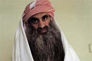 FILE - This July 2009 photo downloaded from the Arabic language web site www.muslm.net shows a man identified by the site as Khalid Sheik Mohammed, the accused mastermind of the Sept. 11 attacks, in detention at Guantanamo Bay, Cuba. Source: AP