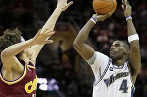 Washington Wizards' Antawn Jamison (4) shoots a three-point shot over Cleveland Cavaliers' Anderson Varejao, from Brazil, in the third quarter of an NBA basketball game Wednesday, Jan. 6, 2010, in Cleveland. Jamison scored 26 points in a 121-98 loss to Cleveland. Source: AFP