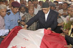 Nepali Congress President Girija Prasad Koirala draping the Nepali Congress flag over the body of NC leader Shailaja Acharya at party office in Sanepa on Friday, June 12, 2009. Acharya passed away this morning. Source: RAJENDRA MANANDHAR