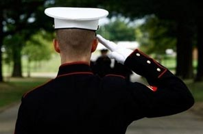 A member of an honor guard team salutes during a funeral at Arlington National Cemetery in Arlington, Virginia. A powerful US senator warned against sending more American troops to Afghanistan, signalling growing skepticism over the war within President Barack Obama's own party. Source: AFP