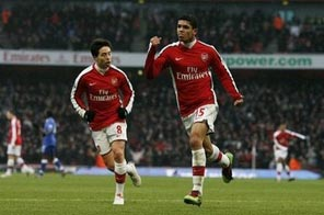 Arsenal's Denilson (right) celebrates scoring a goal during their Premier League match against Everton at the Emirates Stadium in London, on January 9. Manchester United claimed top spot at the weekend with a Wayne Rooney-inspired 4-0 demolition of Hull, but Arsenal will move back above them and into pole position if they can take all three points from their trip to Aston Villa. Source: AFP