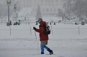 A skier passes infront of the Capitol under heavy snowfall on December 19 in Washington, DC. Source: AFP