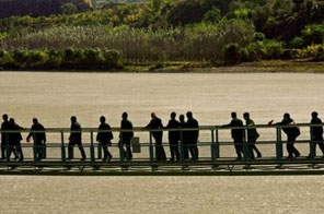 File photo shows people crossing a suspension bridge over the Yellow River in central China. A burst oil pipeline in north China has spewed thousands of gallons (litres) of diesel into a major tributary of the Yellow River, state media said Sunday.c Source: AFP