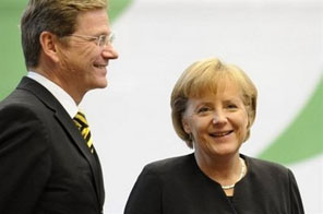 German Chancellor Angela Merkel (R) and Free Democrats Party (FDP) chairman Guido Westerwelle. Germany's newly elected coalition got set for government on Saturday after adopting a common programme in a late-night meeting aimed at guiding the country out of its worst recession since World War II. Source: AFP