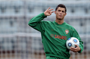 Photo taken on March 30, 2009 of Portuguese and Manchester United winger Cristiano Ronaldo gesturing during a training session in Lausanne. Manchester United have agreed to sell Cristiano Ronaldo to Real Madrid for a world record 80 million pounds (130 million dollars, 94 million euros), the club said on June 11, 2009. Source: AFP
