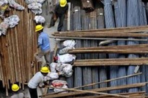 Construction workers sort steel rods at a building site in Shanghai. The world's second-largest producer of iron ore, Rio Tinto's chief export market is fast-industrialising China. Source: AFP