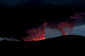In this photo released by the Congolese Wildlife Authority, Virunga National Park, showing the scene as the Nyamulagira volcano erupts early Saturday, Jan. 2, 2010. A government official says the volcano erupted in eastern Congo, sending lava toward a national park, thereatening wildlife, in the sparsely populated region. Source: AP Photo/Congolese Wildlife Authority, Virunga Nat