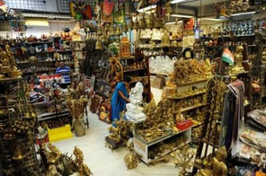 A customer at a handicrafts emporium in Ahmedabad on November 17. India's economy grew by a much faster than expected 7.9 percent in the three months to September from a year earlier, pointing to the country's emergence from the global financial crisis. Source: AFP