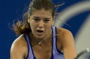 Sorana Cirstea of Romania hits a return against Samantha Stosur of Australia during their singles match of the first session of the Hopman Cup in Perth which Cirstea won 3-6, 6-4, 6-3. Romania have stunned top seeds Australia with an upset 2-1 win in their Group A tie at the mixed teams Hopman Cup at Perth's Burswood Dome. Source: AFP