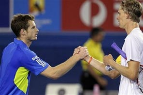 Andy Murray of Britain, left, is greeted at the net by Kevin Anderson of South Africa after winning their Men's singles first round match at the Australian Open tennis championship in Melbourne, Australia, Monday Jan. 18, 2010. Source: AP