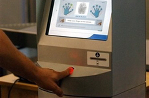 A 'verification kiosk' featuring fingerprint and iris scans is seen displayed at an airport in Minneapolis, US. Source: AFP