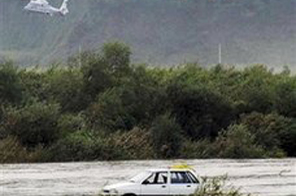 Helicopters of the National Emergency Management Agency fly to search missing people on the Imjin River in Yeoncheon, South Korea, Sunday, Sept. 6, 2009. Six South Koreans camping and fishing along a river flowing from North Korea were missing Sunday after it suddenly rose, possibly because a new dam in the North released a large amount of water without warning, officials said. Source: Agencies