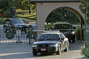 Two vehicles with the Florida Highway Patrol exit the front gate of Isleworth where Tiger Woods lives in Windermere, Fla., Sunday, Nov. 29, 2009 Source: AP