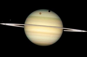 The moons of Saturn passing in front of their parent planet. A tempest that erupted on Saturn in January has become the Solar System's longest continuously observed lightning storm, astronomers reported Source: AFP