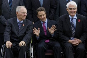 German Finance Minister Wolfgang Schaeuble, left, U.S. Treasury Secretary Timothy Geithner, center, and British Treasury chief Alistair Darling, right, are seen during a group photo session at the G20 Finance Ministers meeting in St. Andrews, Scotland, Saturday, Nov. 7, 2009. Source: AP