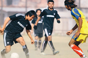 Action in the match between Patan Multiple Campus and Triton College (right) at the Akhil Cup Inter-college Football Tournament on Wednesday. Source: THT