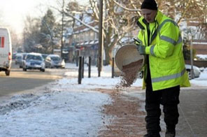 A council worker grits the pavement in Manchester. The British economy, forecast to emerge soon from recession, will likely shrug off the most brutal winter in decades as many Britons simply delay purchases and work from home to beat the big freeze. Source: AFP