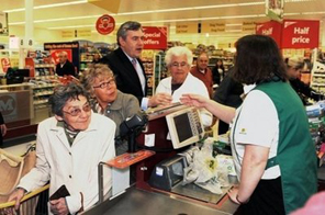 British Prime Minister Gordon Brown (C) meets members of staff and customers at a supermarket in Rochester, Kent. Britain entered its first full day of campaigning Wednesday for a May 6 general election, with party leaders set for a final parliamentary showdown ahead of the vote Source: AFP