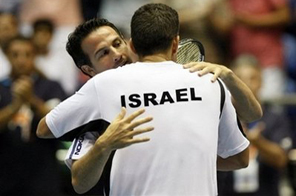 Israel's Harel Levy celebrates with team captain Eyal Ran (background) at their Davis Cup tennis match in Tel Aviv in early July. The country goes into the first day of their Davis Cup semi-final tie with Spain on Friday buoyed by the absence of world number three Rafael Nadal from the defending champions' line-up. Source: AFP