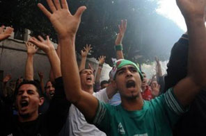 Football fans in Algiers chant as they wait to buy tickets to see their national squad take on Egypt Source: AFP
