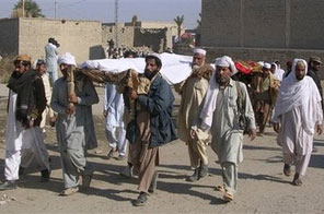 Local residents carry bodies of victims of Friday's suicide car bombing for funeral prayer in Shah Hasan Khel village near Lakki Marwat, Pakistan on Saturday, Jan. 2, 2010. A northwest Pakistani village that tried to resist Taliban infiltration mourned on Saturday the victims of an apparent revenge suicide bombing that killed scores of residents during a volleyball game. Source: AP