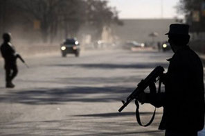 Afghan policemen on guard in Kabul on January 18. Four policemen were shot dead in southern Afghanistan on Tuesday, an official said, suggesting the killings were carried out by Taliban insurgents. Source: AFP