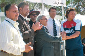 Nepali Ambassador to Kuwait Madhuwan Poudel giving away the man of the match award to Sanjam Regmi after Nepal's victory over Kuwait in the ACC Trophy Elite Cup league match at the Hubara Grounds in Kuwait on Tuesday. Source: THT