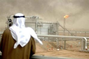 An employee of the Kuwait Oil Company inspects a field near Kuwait City. Kuwait's Oil Minister Sheikh Ahmad Abdullah al-Sabah ruled out any OPEC production increase this year and predicted oil prices would remain at 60-80 dollars a barrel. Source: AFP