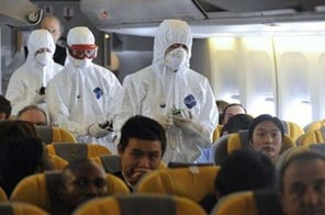 Chinese health authority staff board a plane in Shanghai to take temperatures. Source: AFP