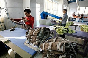 Employees work at the Nile Textile Group factory in the free zone of Port Said, 220 kms northeast of Cairo. With cheap labour, investment incentives and unrestricted exports, one Chinese textile group has turned to Egypt as an ideal location to produce its ready-made garments, beating stiff competition at home. Source: AFP