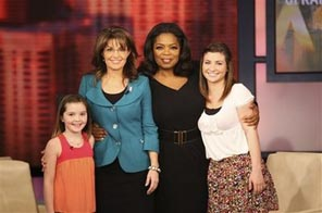 This photo taken Wednesday, Nov. 11, 2009 and released Friday, Nov. 13, 2009 by Harpo Productions, Inc., shows talk-show host Oprah Winfrey, second from right, with former Republican vice presidential candidate Sarah Palin and her daughters, Willow, right, and Piper, left, during the taping of 'The Oprah Winfrey Show' in Chicago. The show will air on Monday, Nov. 16. Source: AP