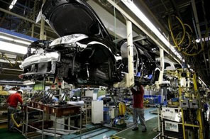 Nissan Motor Company workers are seen on a production line at the company's Tochigi Plant in the town of Kaminokawacho, in Tochigi prefecture. Japan's factory output edged up by 0.5 percent in October from September, marking an eighth straight monthly gain, official data showed Monday. Source: AFP