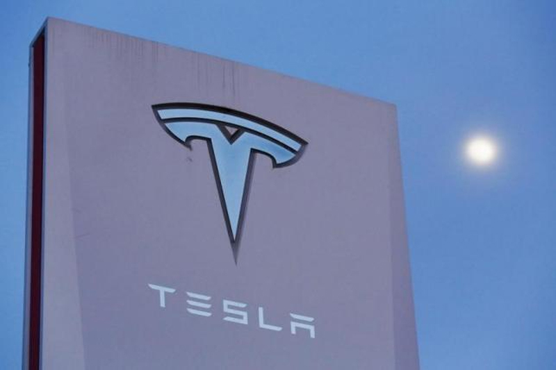 Signage is displayed outside of Tesla Motors before the Tesla Energy Powerwall Home Battery event in Hawthorne, California April 30, 2015. Photo: Reuters