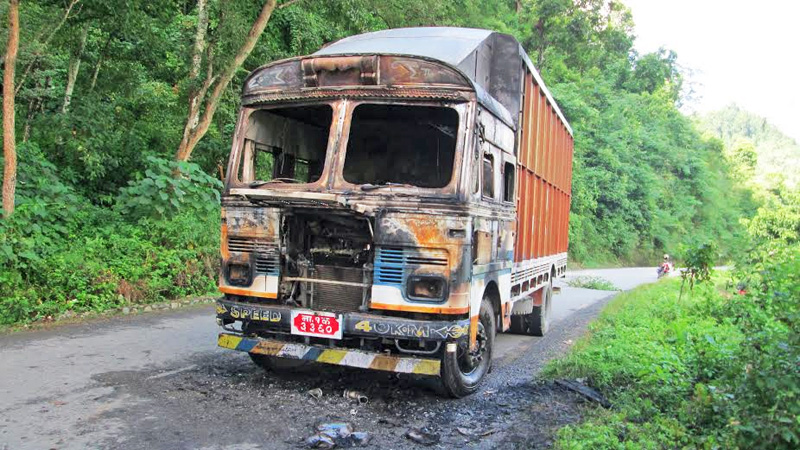 A truck torched by CPN Maoist cadres in Tanahun on Sunday, September 20, 2015. Photo: Madan Wagle