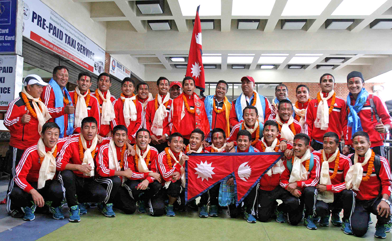 The U-16 football team members pose for group photo with officials upon their arrival from Kyrgyzstan, in Kathmandu  on Tuesday. Nepal earned a berth in the AFC U-16 Championship as one of the four best runners-up teams in the qualifiers. Photo: Udipt Singh Chhetry/ THT