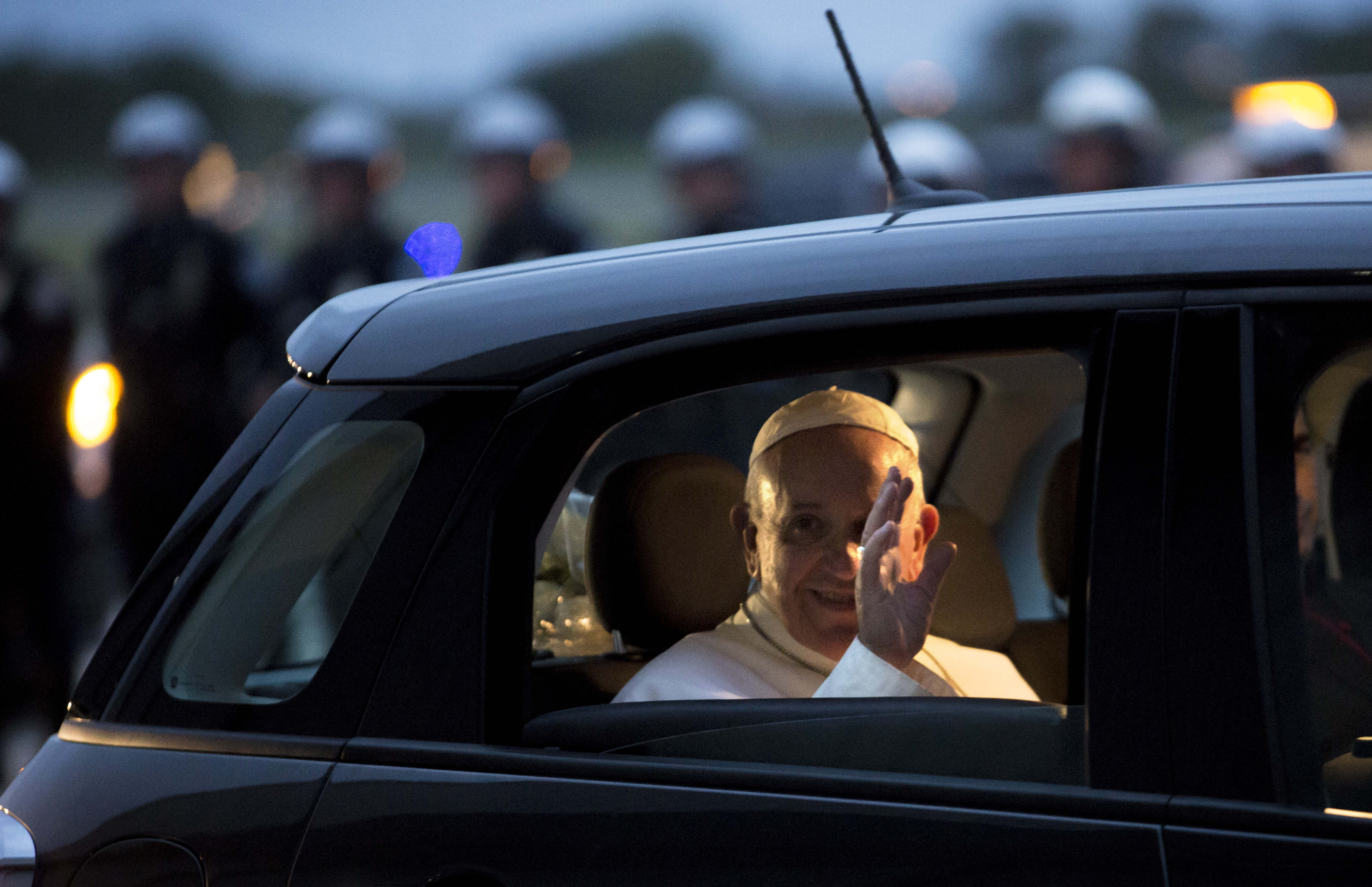 Pope Francis waves from his Fiat as he prepares to depart for Rome at Philadelphia International Airport in Philadelphia on Sunday, Sept. 27, 2015. (AP Photo/Laurence Kesterson)