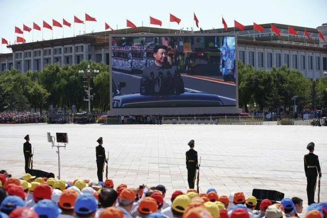 Chinese President Xi Jinping is shown on a big screen at Tiananmen Square as he reviews troops at the beginning of the military parade marking the 70th anniversary of the end of World War Two, in Beijing, China, September 3, 2015 REUTERS/Damir Sagolj