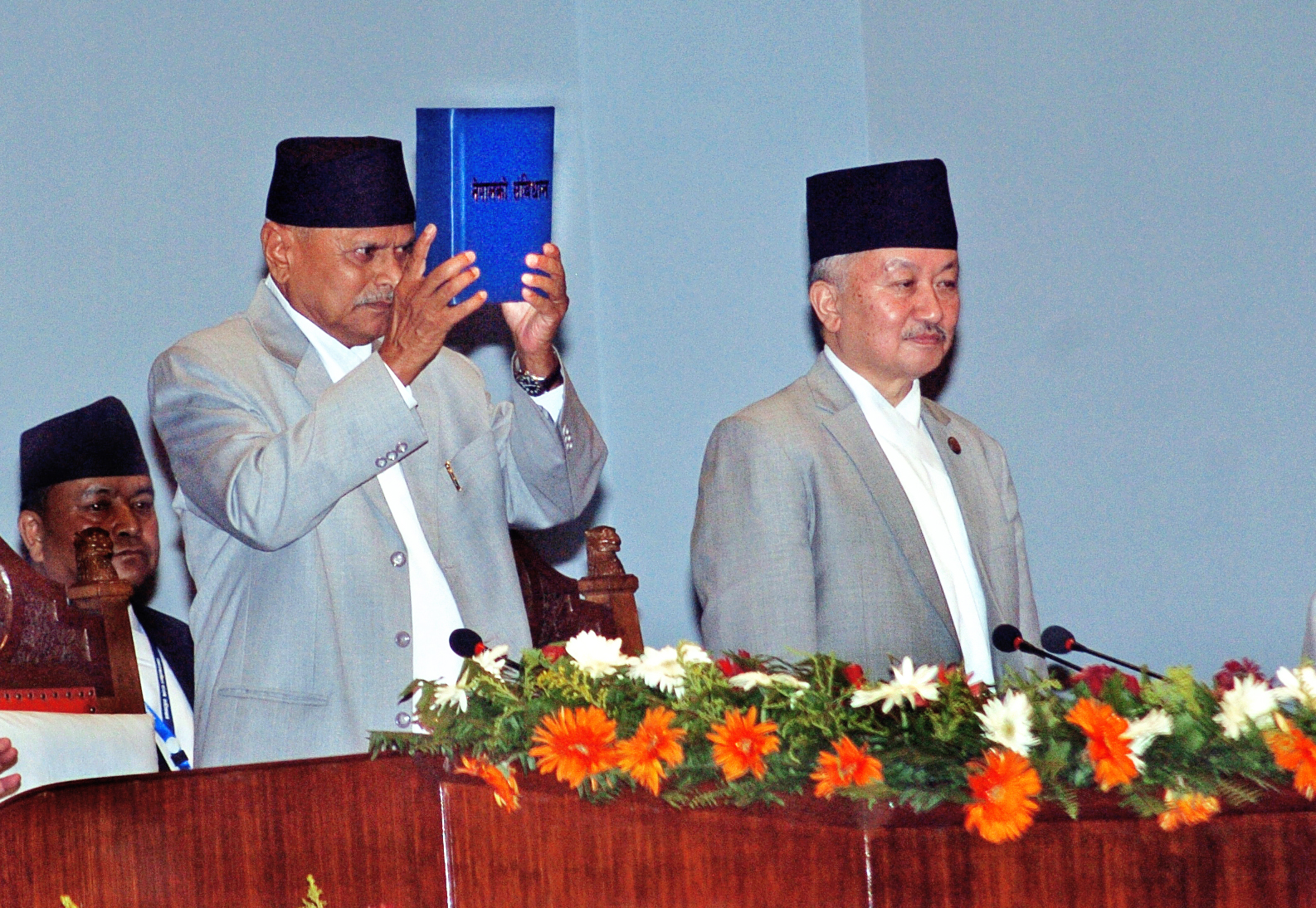 The then President Ram Baran Yadav promulgating Nepalu2019s  Constitution after signing the copies of the constitution authenticated by CA Chairman Subas Chandra Nembang during a special function at the Constituent Assembly Hall on Sunday. Photo: Dhruba Ale/ THT