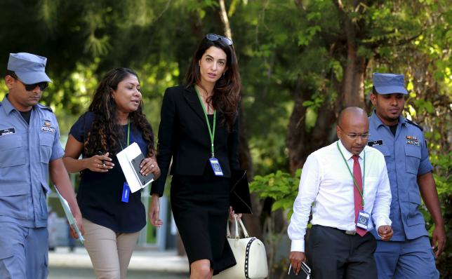 Amal Clooney (centre), lawyer of former Maldives president Mohamed Nasheed, leaves Maafushi prison after meeting Nasheed in the Maldives September 8, 2015. Photo: Reuters