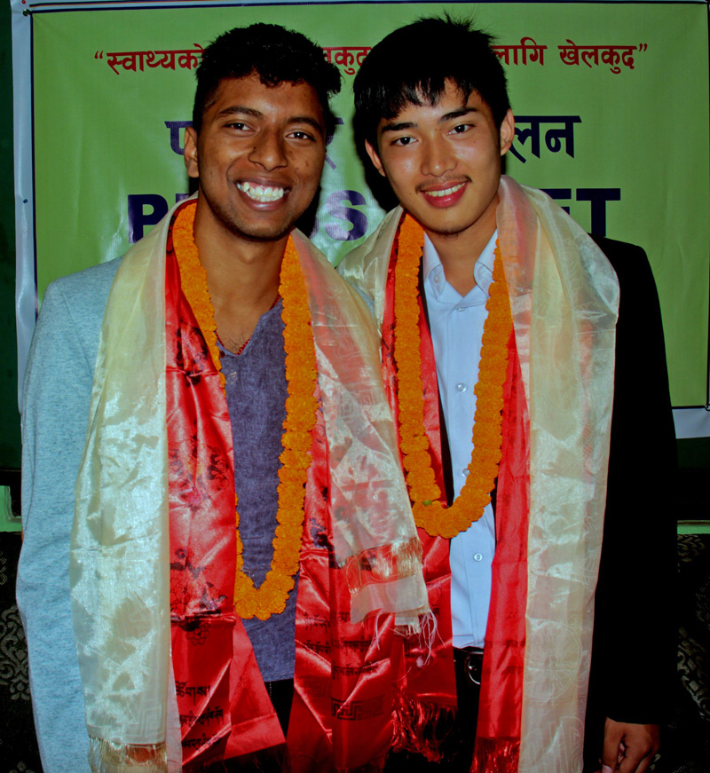 Rupesh Jaiswal (left) and Bibek Thing pose for a photograph, before heading to Russia for scholarship, at the farewell programme in Kathmandu on Thursday. Photo: THT