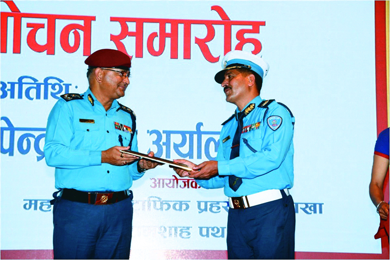 IGP Upendra Kant Aryal (left) receiving an  album of traffic awareness songs from DIG Jaya Bahadur Chand, chief of Metropolitan Traffic Police Division, in Kathmandu, on Friday. Photo: THT