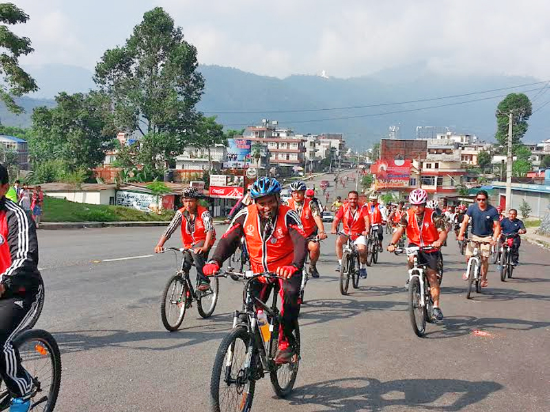 Participants taking part in  a cycle rally organised by the Cycle City Pokhara in coordination with the Jayanti Smriti Prathisthan in Pokhara of Kaski district on Tuesday, September 29, 2015. Photo: Rup Narayan Dhakal