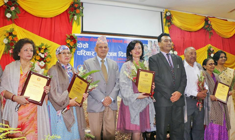 Representatives of various agencies posing for a picture after receiving honour from the Ministry of Health and Population on the occasion of National Family Planning Day, in Kathmandu, on Friday. Photo: THT