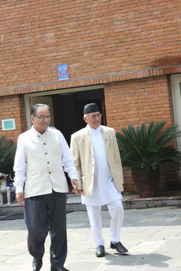 File- CPN-UML Chairman KP Sharma Oli (right) and the then UCPN-Maoist Chairman Pushpa Kamal Dahal emerge from a meeting at the PM's residence in Baluwatar, on Thursday, September 10, 2015. Courtesy: Twitter/KP Sharma Oli