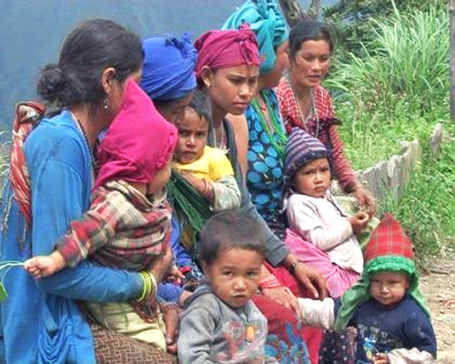 Mothers waiting for their turn to get their children checked at Jharlang Sub-health Post in Jharlang VDC of northern Dhading district on Saturday, September 26, 2015. Photo: Keshav Adhikari