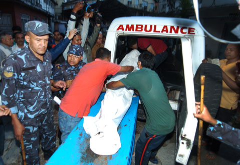 Police taking the body of Nanda Prasad Adhikariu201a who had been staging fast-unto-death with his wife Ganga Maya for the past 11 monthsu201a is being shifted from Bir Hospital in Kathmandu on Monday, September 22, 2014. Photo: THT/File.