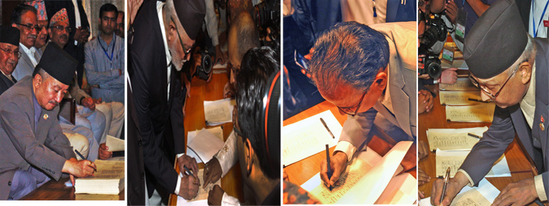Constituent Assembly Chairman Subas Chandra Nembang (left) authenticating the Nepalu0092s Constitution after other CA members, including PM Sushil Koirala, Pushpa Kamal Dahal and KP Sharma Oli signed it on Friday. Photo: THT