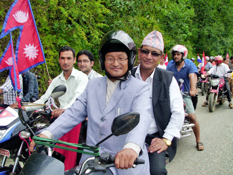 People take out a motorcycle rally in Panchthar on the occasion of promolguation of new constitution 2072. Photo: Laxmi Gautam