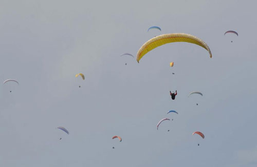 File- Participants of the 15th paragliding competition flying over the sky in Pokhara on Sundayu201a March 02u201a 2014.  Photo: THT/File