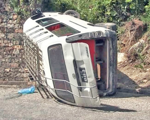 A microbus that turned turtle at Kamere along the  Kalu Pandey Marg in Dhading district, on Tuesday, September 22, 2015.  Photo:  Keshav Adhikari